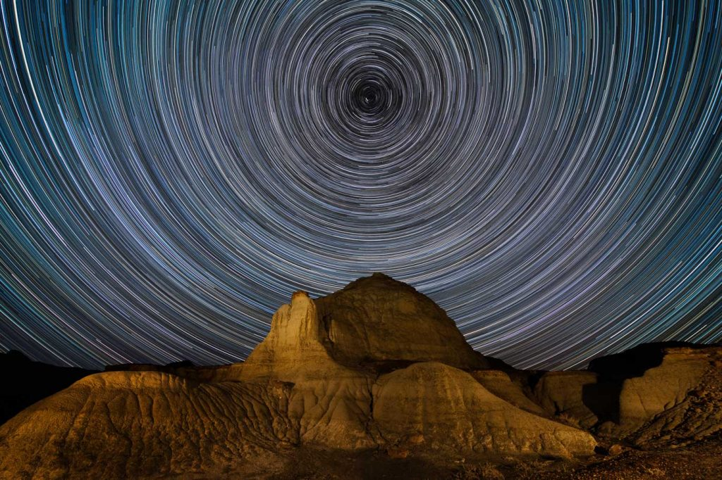 Concentric circle star trails over a formation in Dinosaur Provincial Park