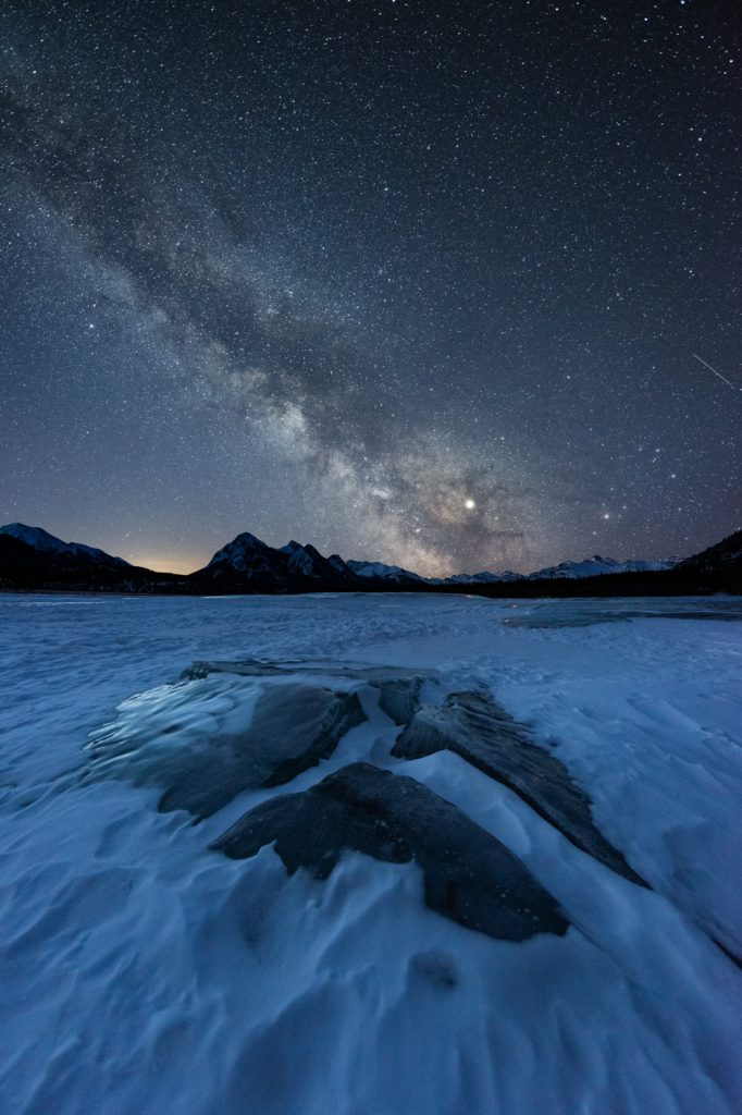 Milky Way over ice blocks and methane bubbles at Abraham Lake in David Thompson Country