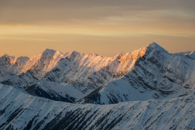 Snow covered Mountains at Sunrise in Highwood Pass
