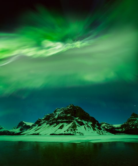 Aurora corona over Crowfoot Mountain, Bow Lake