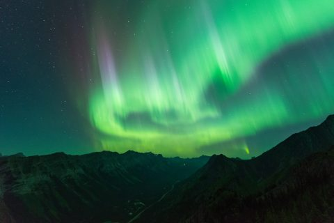 Big aurora swirls and spike above Kananaskis mountains