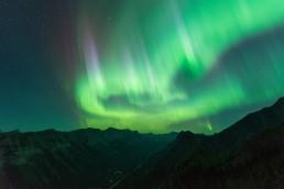 Big aurora swirls and pillars above Kananaskis mountains