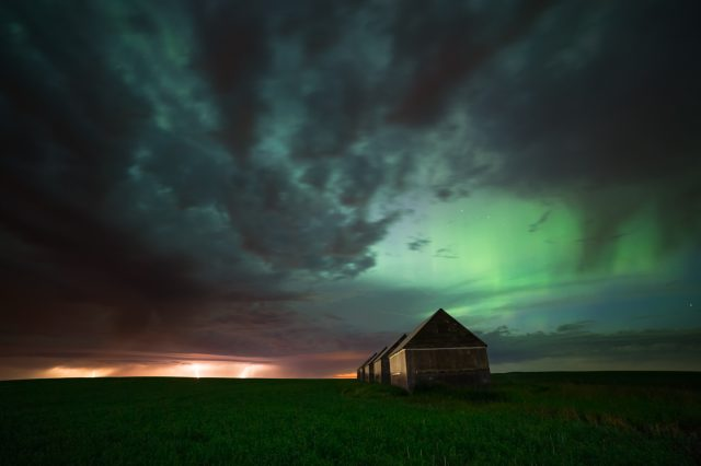 Lightening storm and geomagnetic storm over barns in Southern Alberta