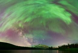 Aurora corona and Milky Way over Two Jack Lake