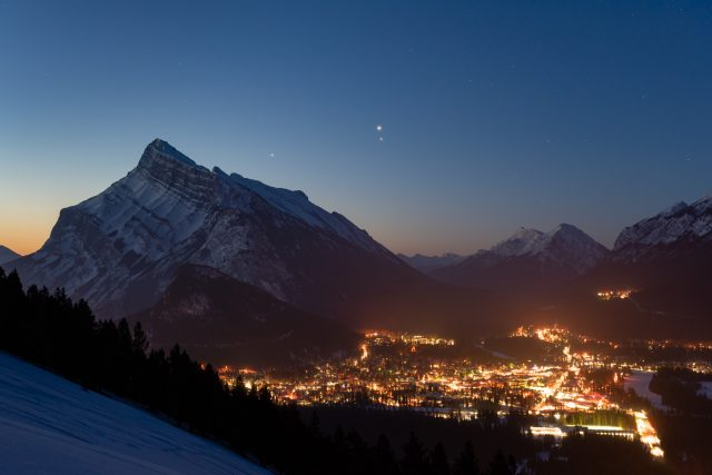 Conjunction of Jupiter and Mars with Saturn behind over Mount Rundle and the Town of Banff