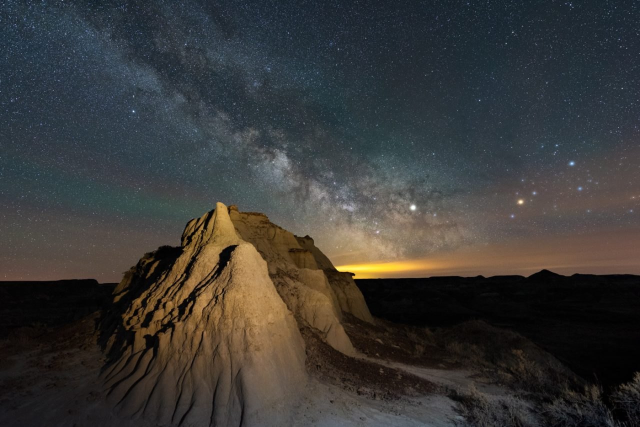 Light painted badlands formation with Milky Way in the sky at Dinosaur Provincial Park