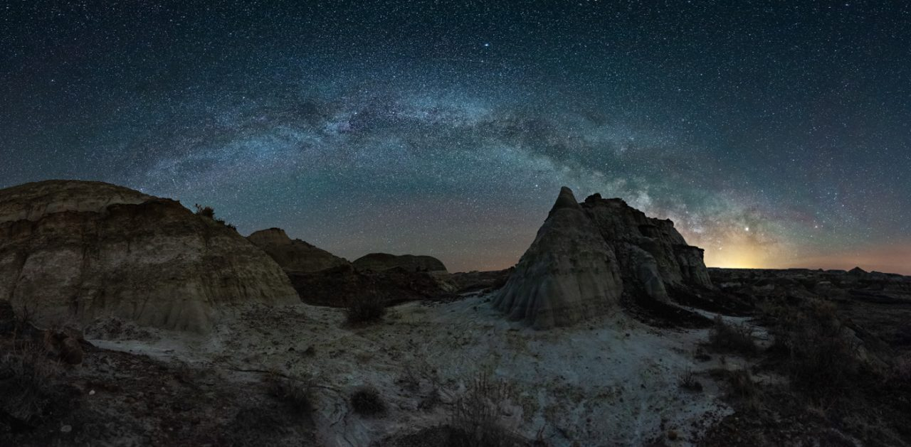 Milky Way panorama of the arc of the galaxy over the badlands in Dinosaur Provincial Park - Monika Deviat