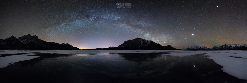 Milky Way arc panorama over Mount Michener and a frozen Abraham Lake