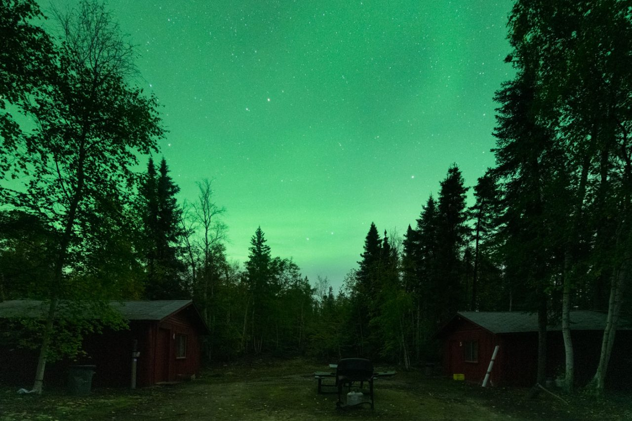 Fly in fishing cabins under Aurora Borealis