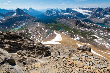 A woman scrambles up Cirque Peak in Banff National Park