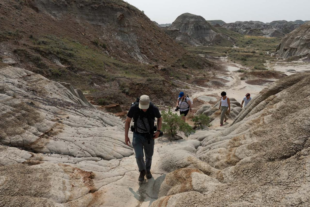 workshop participants hiking through the badlands
