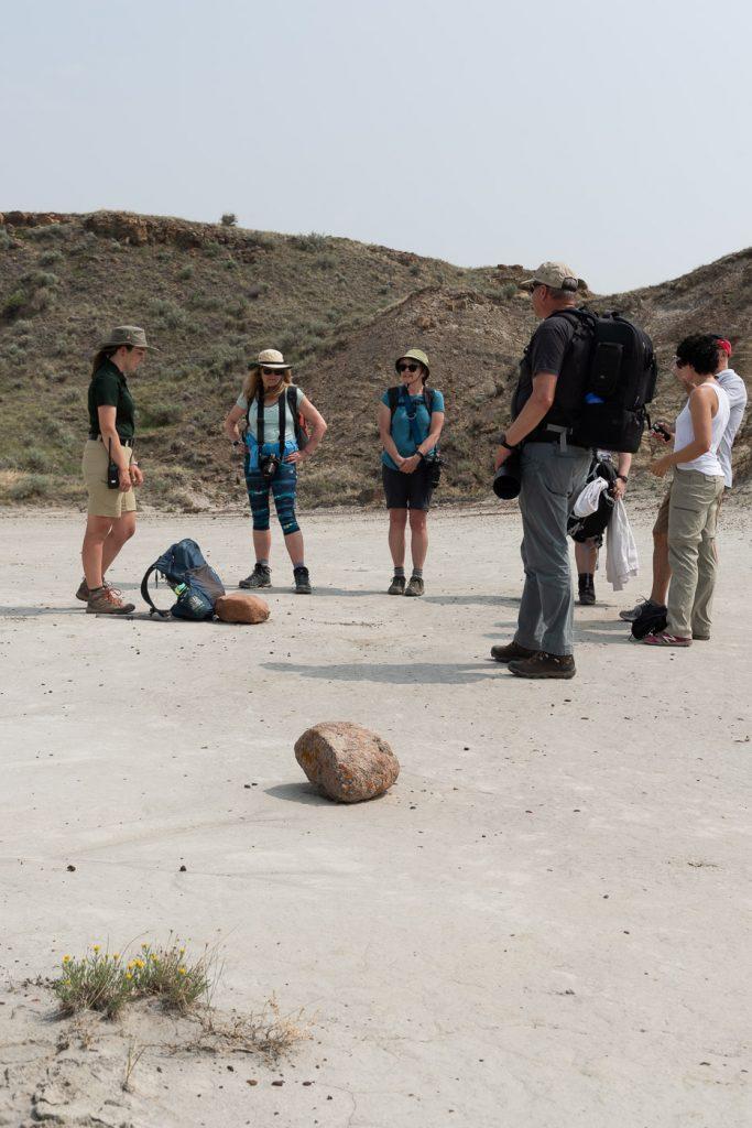 Dinosaur provincial park guide explaining glacial erratics to the photography workshop group