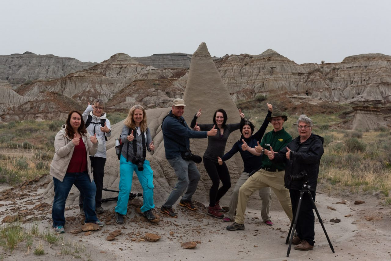 Thumbs up group shot from the dinosaur at night photography workshop