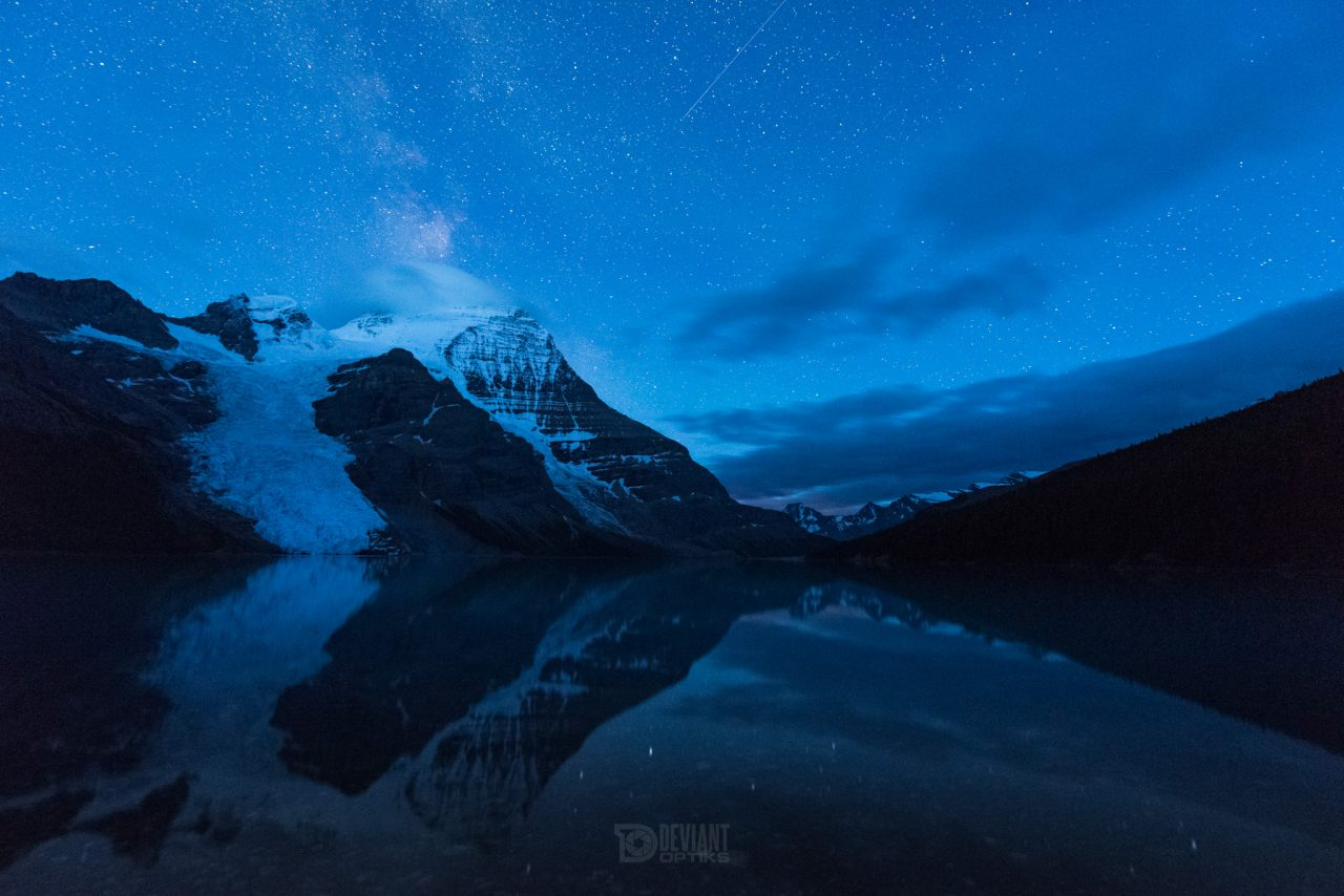 Blue hour at Berg lake with Mount Robson reflecting in the water
