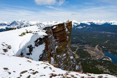 Hikers walk along the distinct layered edge of Table Mountain's ridge.