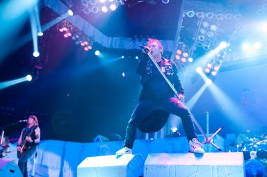 Bruce Dickinson standing on speakers and singing at Iron Maiden Concert