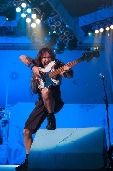Steve Harris playing bass and pointing it at the crowd during Iron Maiden Concert