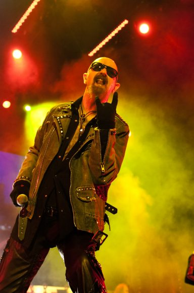 Rob Halford throwing the horns at Judas Priest concert at the Saddledome