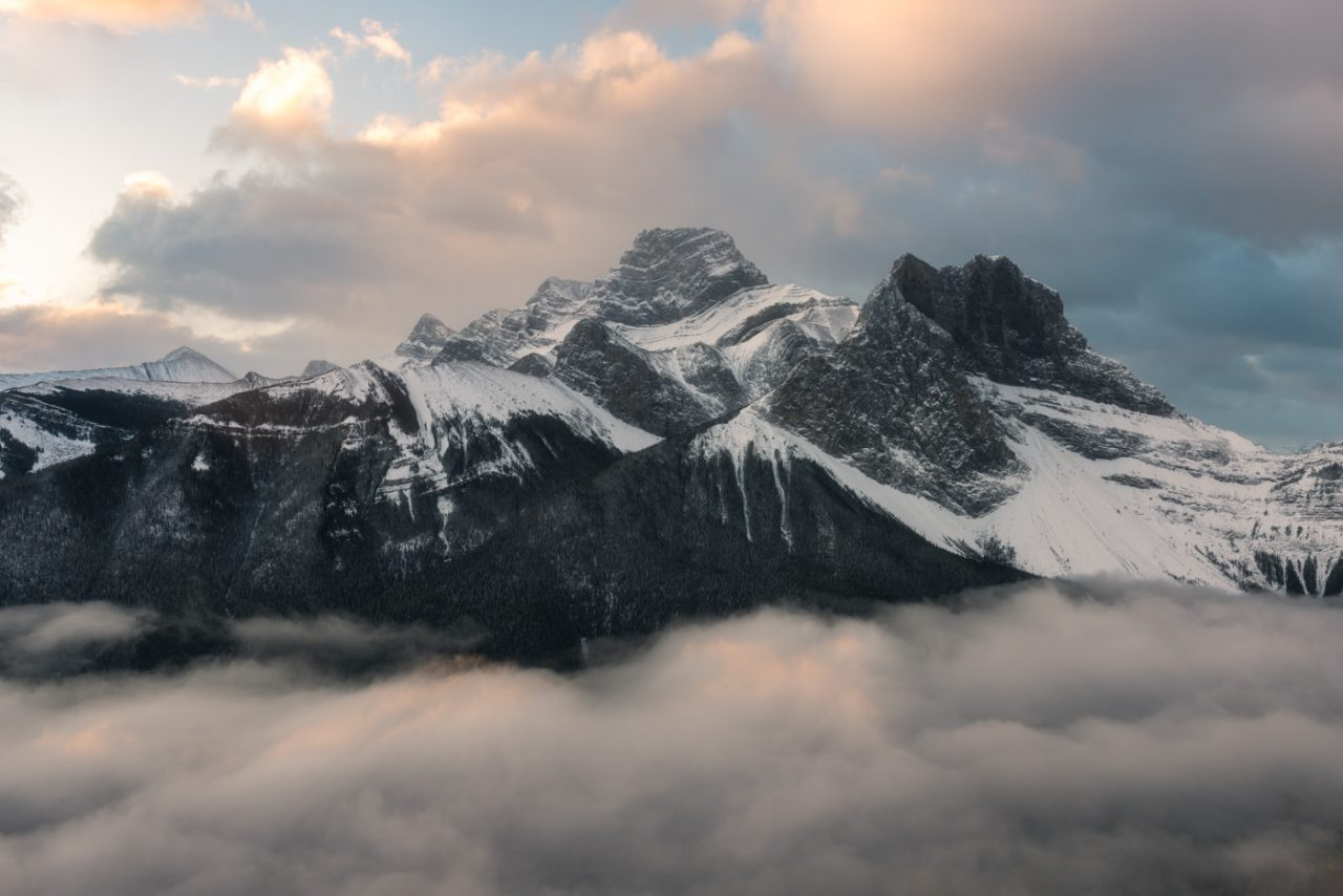 Mount Lougheed surround by sunlit inversion and clouds in the Canadian Rockies
