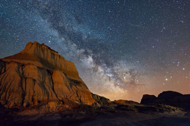 Milky way and low level lighting on massive sandstone mound at Dinosaur Provincial Park