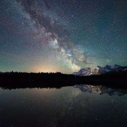 Milky Way and mountains reflecting in Herbert Lake, Icefields Parkway