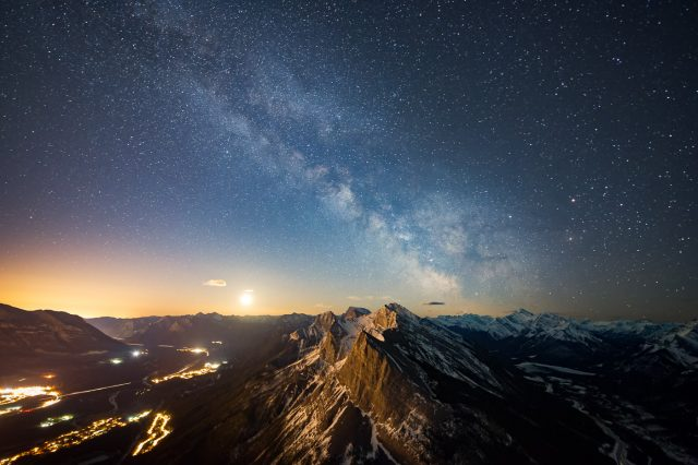 Milky Way with moon rise over Ha Ling and town of Canmore