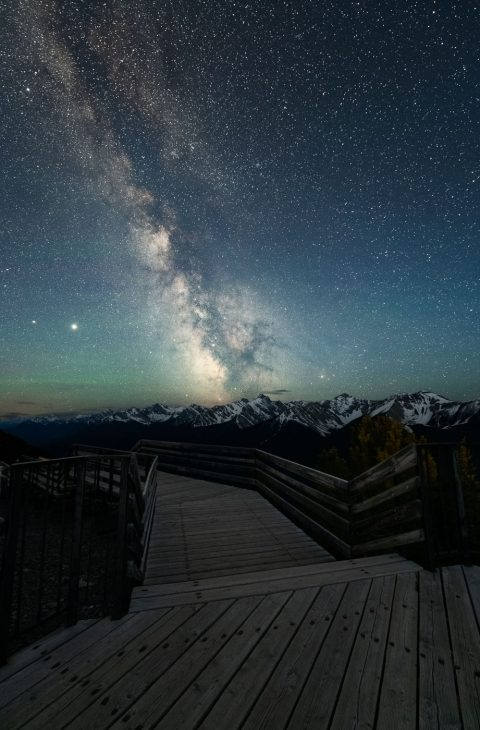 Milky Way above the Massive Range and wooden board walk in the Canadian Rockies, Banff