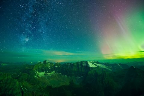 Milky Way and Northern Lights over the valley of the ten peaks and Horseshoe Lake in Banff