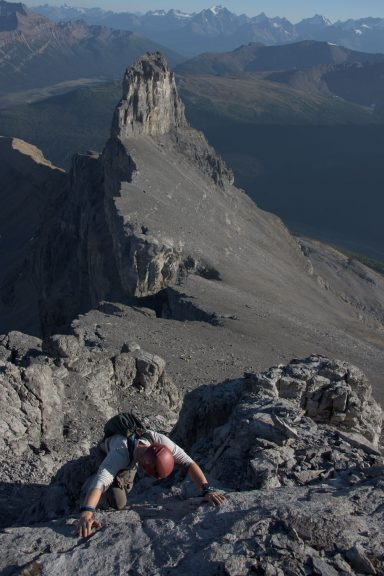 A man in a red helmet scrambles the final section of Molar Mountain