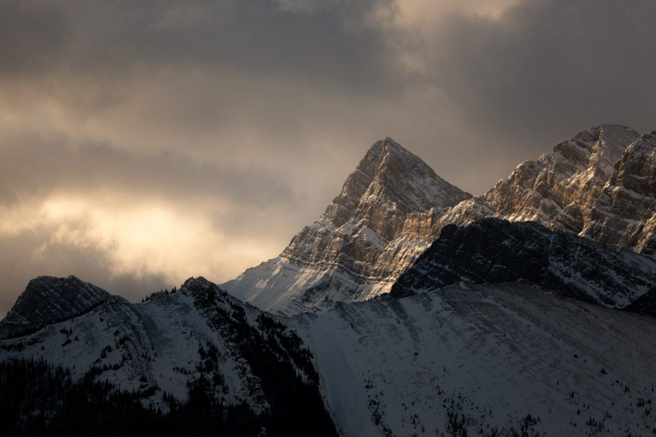 Warm sunlight hitting snowy peak in Kananaskisk
