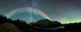 STEVE/sub auroral arc, picket fence, Milky Way and Northern Lights panorama over Peyto Lake,