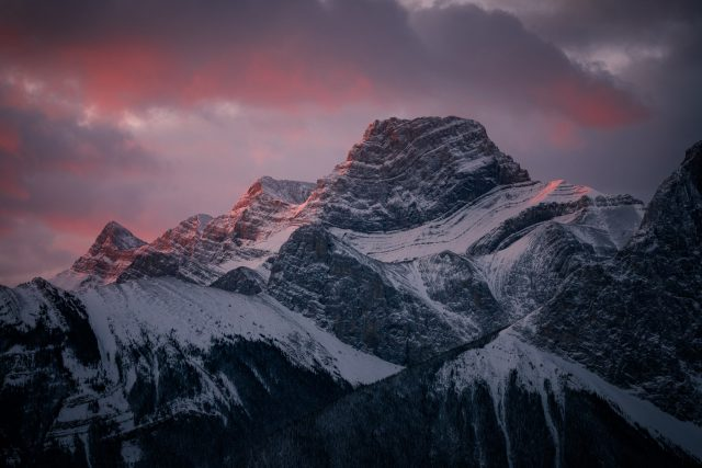 Mount Lougheed covered in snow with pink Alpen Glow