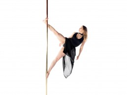Woman in black dress holding foot flag on pole