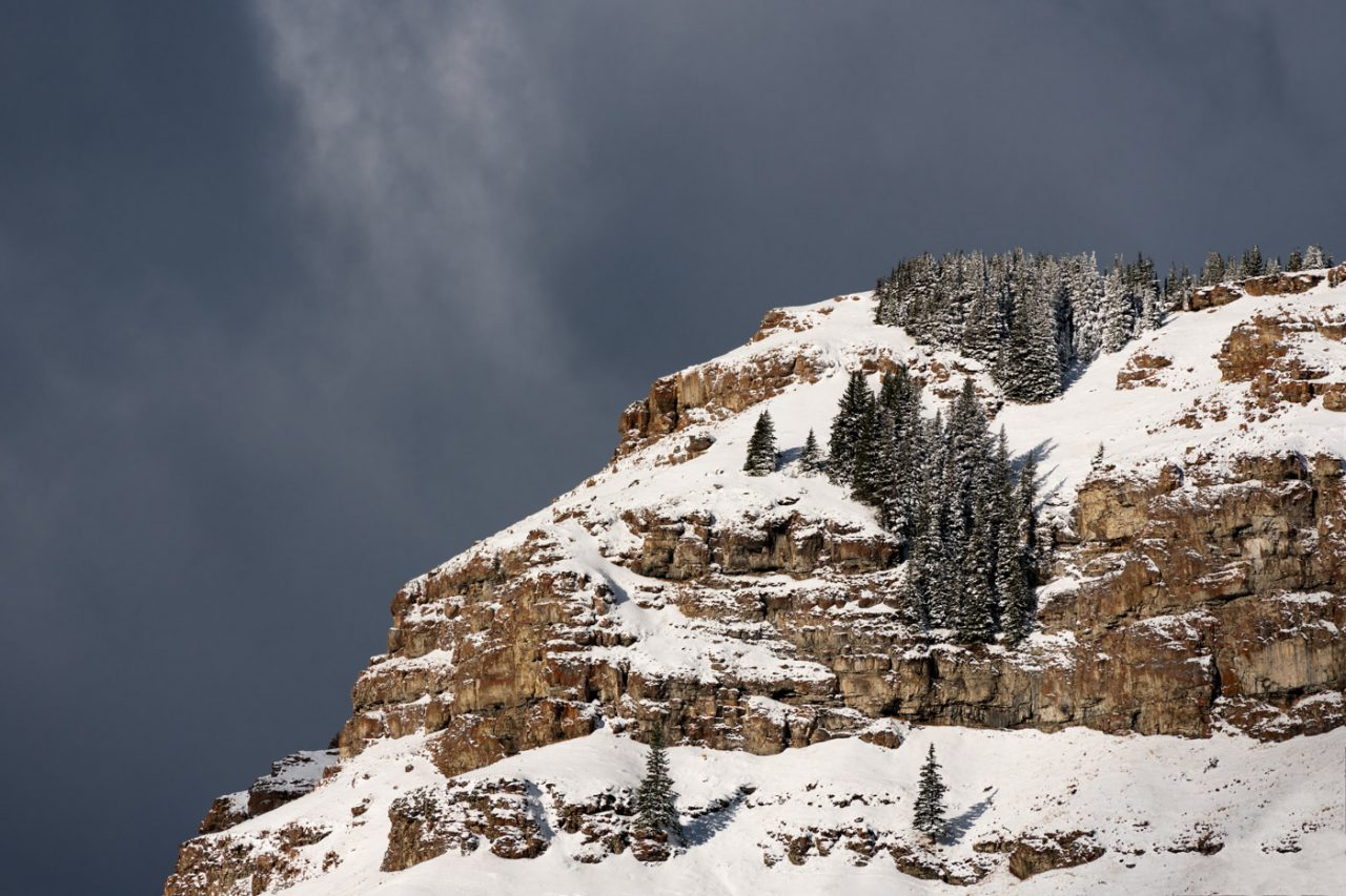 Snow covered blocky ridge with dramatic clouds