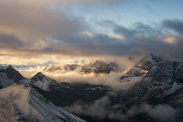 Clouds and fog rolling through mountains in Burstall Pass at Sunrise