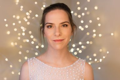 Headshot with ring light bride with pearl dress