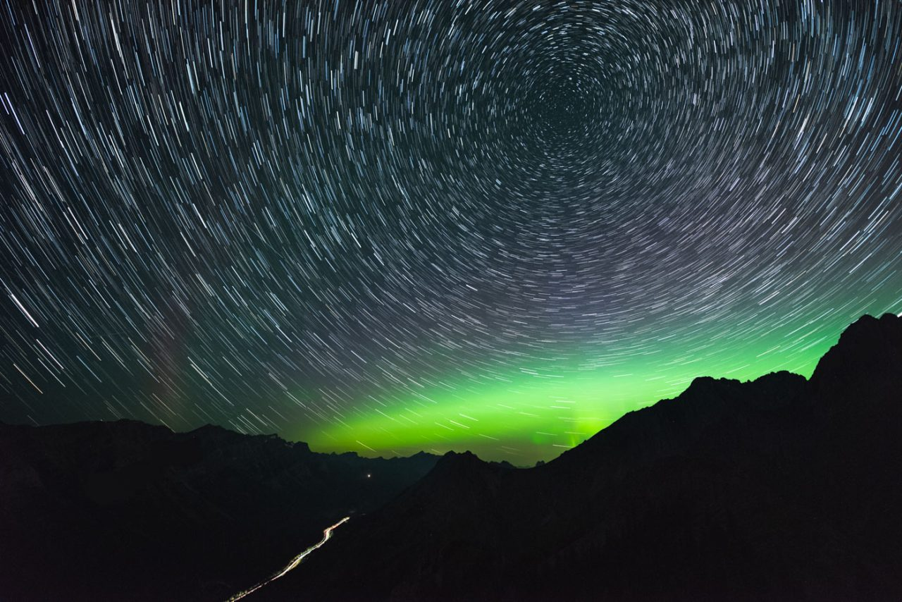 Star Trail with Aurora over car light trail in Kananaskis Alberta