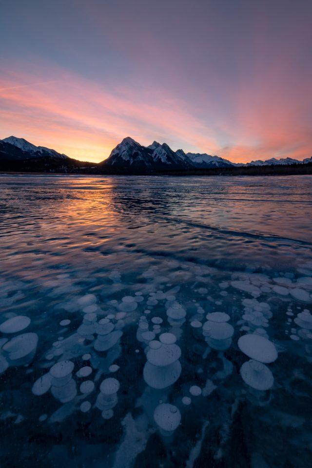 Colourful sunrise and methane bubbles at Abraham Lake