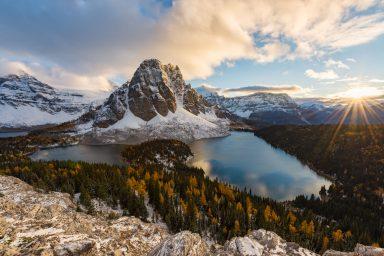 unset sunburst overlooking Sunburst Peak, Lakes, Assiniboine and larches from the Nub