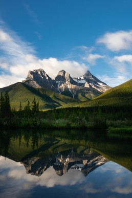 Three sisters reflecting in Policeman's creek during a green lush summer