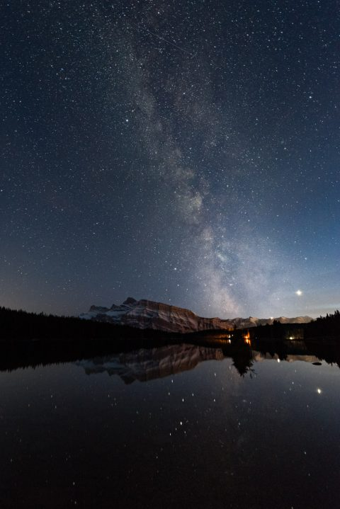 Milky Way and mount rundle reflecting in still two jack lake