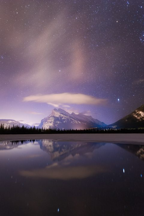 Clouds and stars reflecting with Mount Rundle in Vermillion Lakes