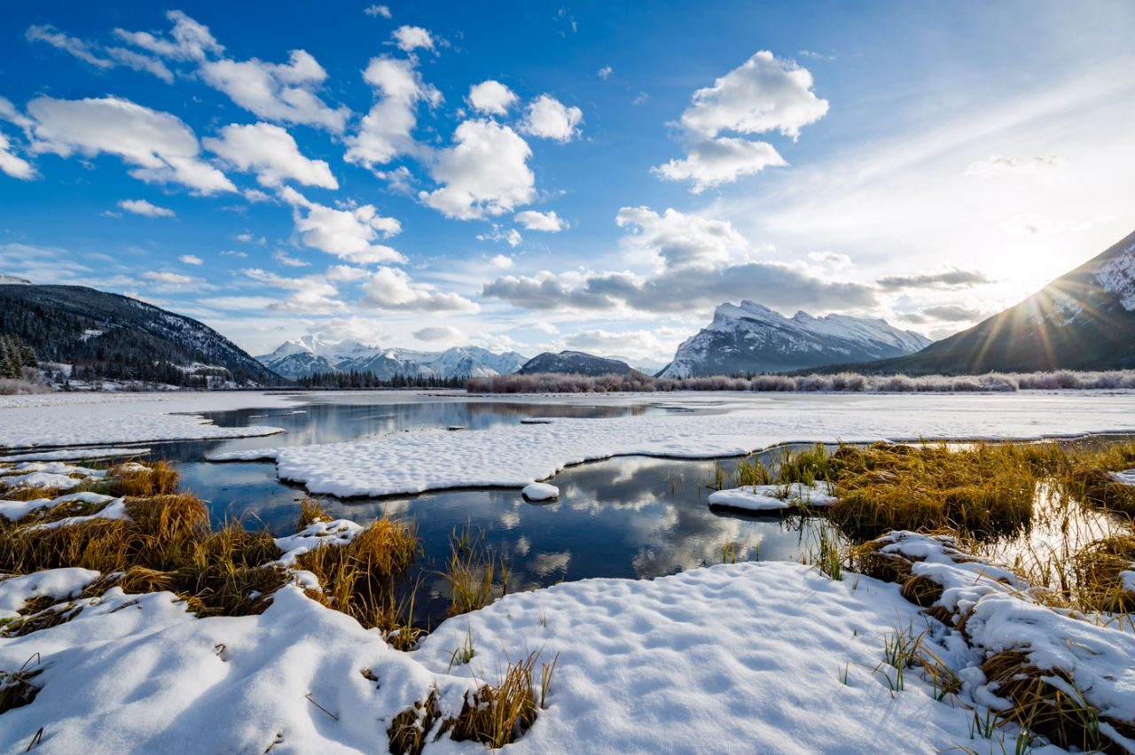 Open water patches and fresh snow during early morning light at Vermillion Lakes