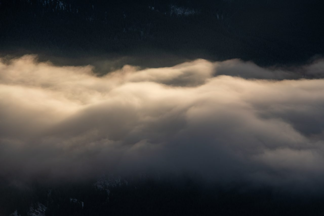 Sunlight hitting the top of cloud inversion