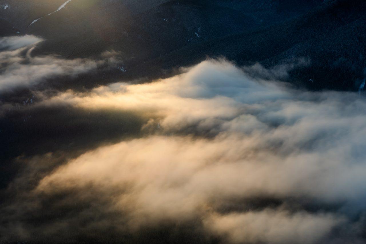 Warm sunlight hitting wispy cloud inversion