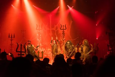 Full stage shot from the crowd of Watain in red lighting at Flame's Central