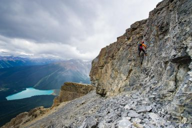 Climber rappels from cliff high above Emerald Lake