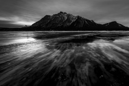 Streaks in ice and clouds around mount michener at Abraham Lake