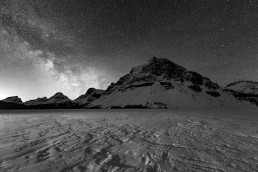 Milky Way rising above Crowfoot mountain and a snow covered bow lake