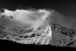 Clouds and snow blowing of Howse Peak